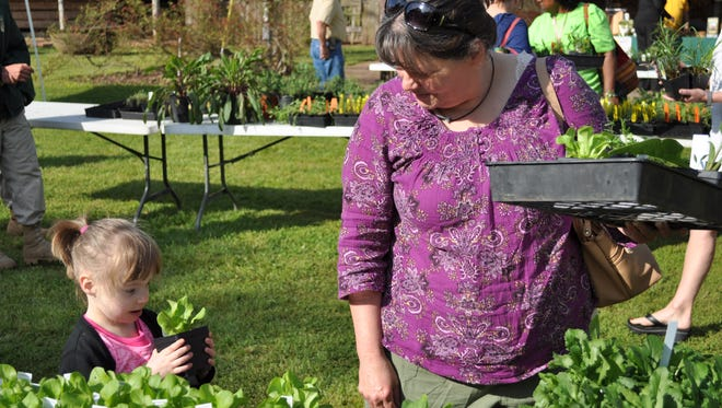 Susan Brown shops with granddaughter Mila Tallman at the Kent Plantation House's 2015 Spring Herb Day.