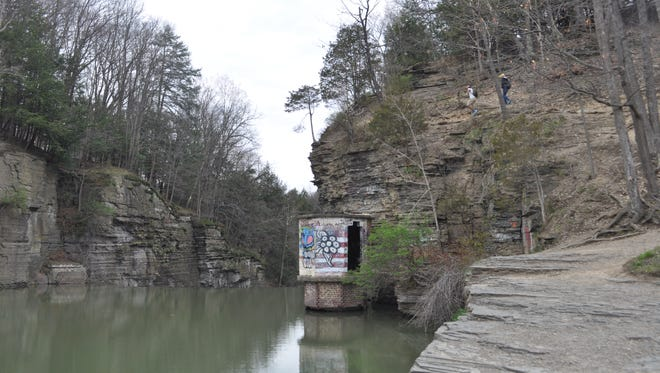 Two high school students, top right, hike out from Second Dam in April. The pair said they had just finished cliff jumping and swimming.