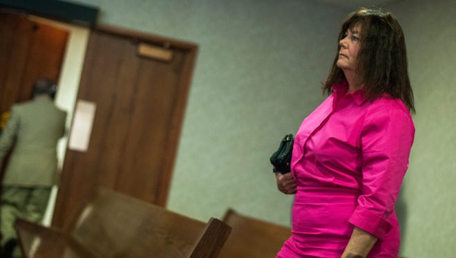 Lynn Higgins, of Cottrellville Township, prepares to leave the courtroom Oct. 17, during a hearing on animal welfare charges.