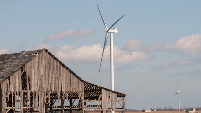 A wind turbine stands in the distance Monday, Feb. 27, in Deckerville.