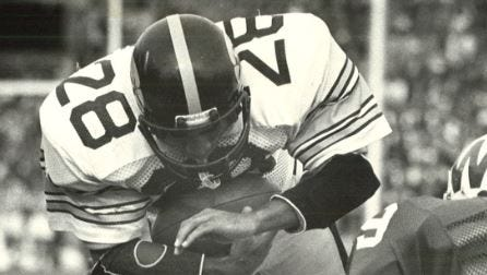 Phil Blatcher scores the first of his two TDs against Wisconsin in 1981 on a goal-line leap.