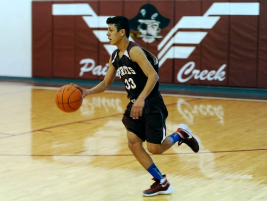 Paint Creek's Manuel Acosta (33) runs the ball down