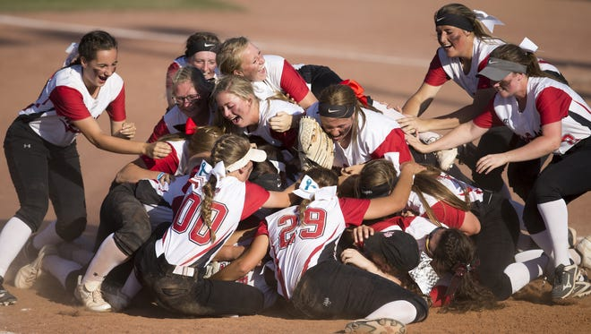 New Palestine celebrates its 3A state softball title Saturday after defeating Kankakee Valley High School 13-6.