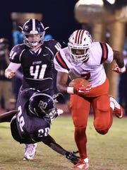 Oakland' JaCoby Stevens breaks a tackle from Siegel's Warren Stovall (20) during Friday's contest.