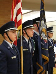 A color guard presents the U.S. and Utah flags at the