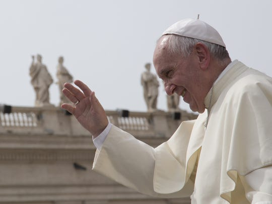Alessandra Tarantino/AP Pope Francis waves after his