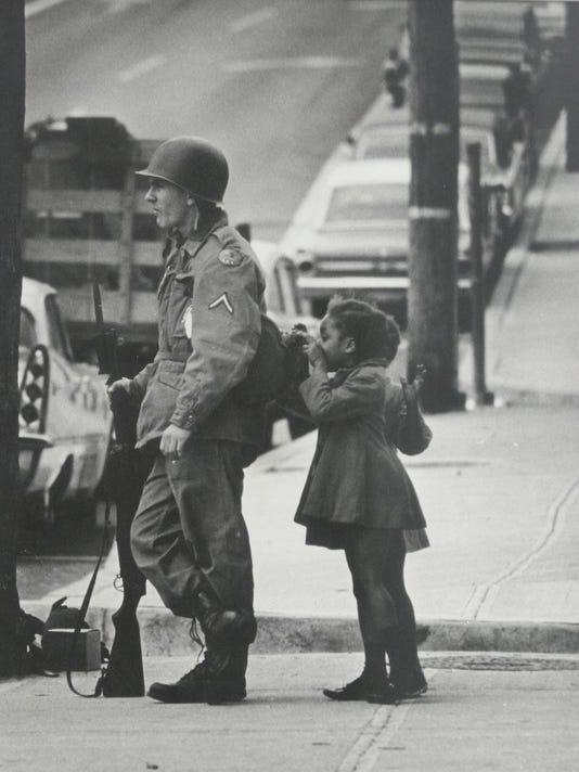 GIRL AND SOLDIER DURING RIOT