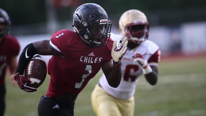 Chiles receiver Kris Reed returns a punt for a first-quarter touchdown in the Timberwolves' 26-3 spring game win over Florida High.