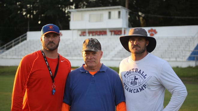Former Jefferson County player and coach Blair Armstrong and twin sons Tyson, left, and Jason have returned home to coach a Tigers program desperate for stability.