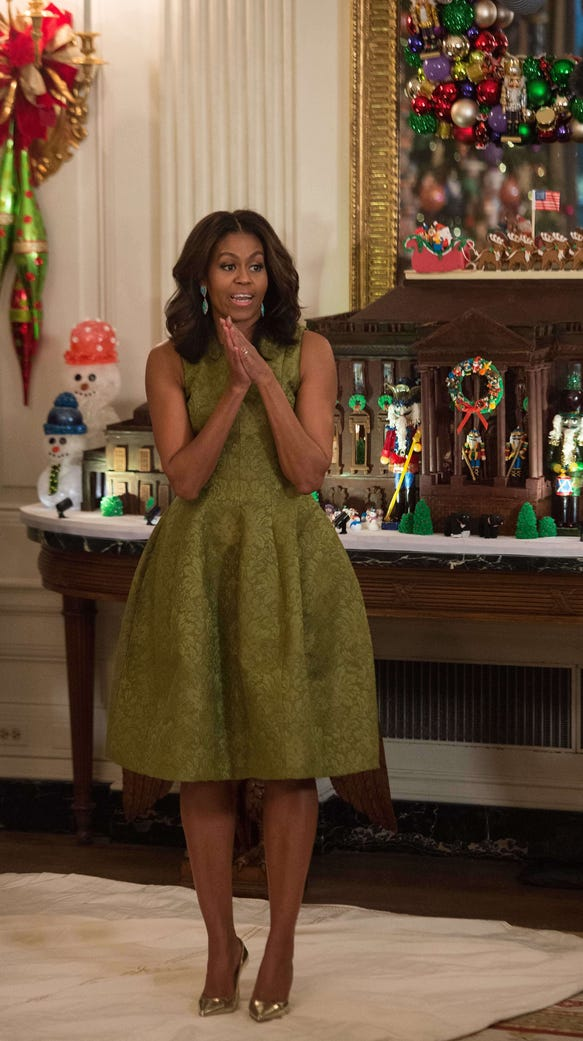 First lady Michelle Obama speaks with reporters at