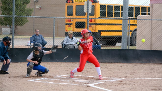 Loving's Andrica Gomez makes contact at the plate in game one against Carlsbad JV on Saturday.