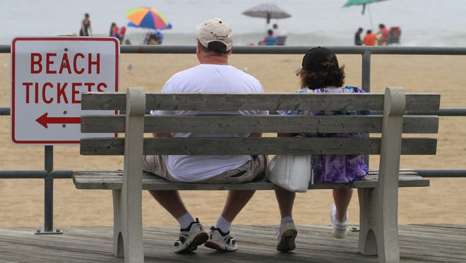 ASB 0709 Asbury Boardwalk and Beach Art  Marc and Deena Platizky, of East Windsor, NJ, observe the sights from a boardwalk bench in Asbury Park, Wednesday, July 9, 2014. Photographer/Mary Frank