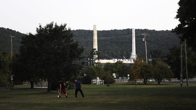 The Invista plant, formerly owned by DuPont, can be seen from Constitution Park on Tuesday, Sept. 25, 2013, in Waynesboro. DuPont polluted the river sometime between the 1960s and 1970s with mercury, which was used as a catalyst in the manufacturing of a rayon fabric. DuPont has since taken responsibility for the pollution of mercury, and developed the South River Science Team with a number of other environmental and health agencies to monitor and clean up the river.