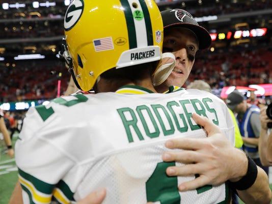Atlanta Falcons quarterback Matt Ryan embraces Green Bay Packers quarterback Aaron Rodgers (12) after the second of an NFL football game, Sunday, Sept. 17, 2017, in Atlanta. The Falcons won 34-23. (AP Photo/David Goldman)