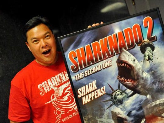 "Lyman Chen, of Brandywine Hundred, jokes around next to a ""Sharknado 2"" movie poster."