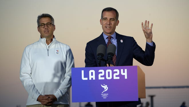 Los Angeles mayor Eric Garcetti (R) and LA2024 bid chairman Casey Wasserman (L) speak about the 2024 Los Angeles Olympic Games bid at press conference at the Annenbuerg Community Beach House at Santa Monica State Beach on May 11.