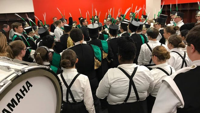 Vestal Central School District Marching Band Director Greg Harris gives the band a pep talk before their third place winning performance in the 2017 New York State Field Band Conference Championship Show.