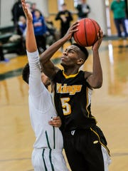 South Brunswick's Tavian Alford (5) powers to the basket against St. Joseph during Saturday's game in Metuchen.