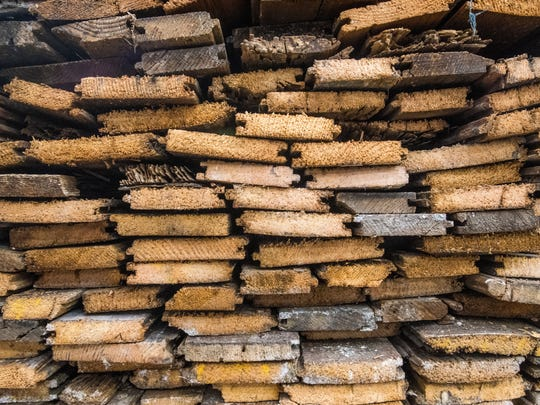 Recycled lumber is stored in the warehouse of Brick+Board,