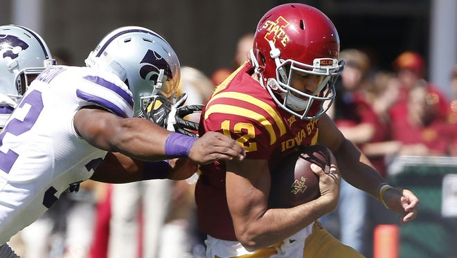 AMES, IA - SEPTEMBER 6: Linebacker Dakorey Johnson #32 of the Kansas State Wildcats tackles quarterback Sam B. Richardson #12 of the Iowa State Cyclones in the second half of play at Jack Trice Stadium on September 6, 2014 in Ames, Iowa. Kansas State won 34-28 over the Iowa State Cyclones.