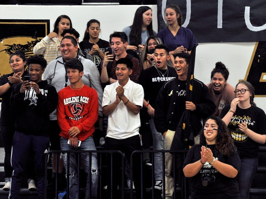 "Abilene High School students react when Laurence Fishburne's name is announced for the upcoming movie, ""Brother's Keeper"", Wednesday  in Eagle Gym. The film is based upon former Reporter-News sports editor Al Pickett's book, with Chad Mitchell, about the 2009 Eagles football championship season."