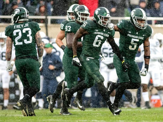 Michigan State's David Dowell (6) celebrates an interception during the second quarter on Saturday, November 4, 2017, at Spartan Stadium in East Lansing.