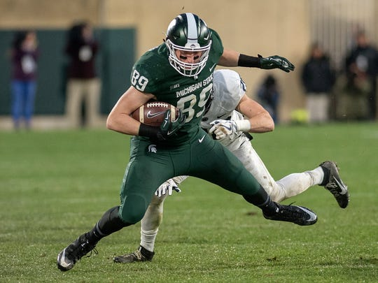 Michigan State's Matt Dotson catches a pass during