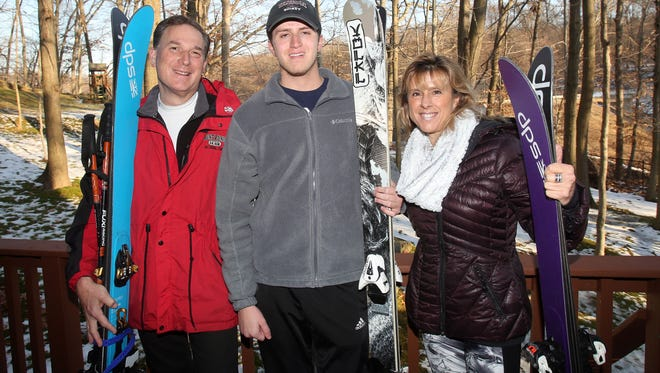 From left, Charles Sanders along with his son Jackson and wife Nina have skied on seven continents. They are photographed at their Mount Pleasant home Dec. 22, 2016.