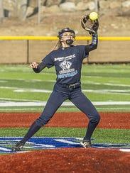Morris Catholic shortstop Stephanie Smith catches the