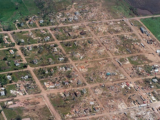 - This aerial view shows the path of destruction that