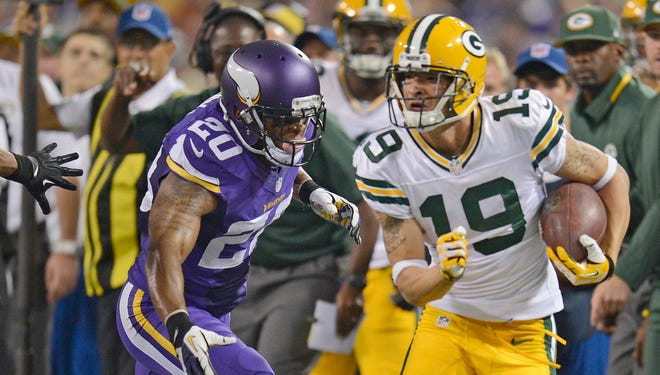 Green Bay Packers rookie Myles White (19) runs with the ball up the sideline chased by Chris Cook (20) of the Minnesota Vikings during the Dec. 12, 2013 game at the Metrodome. Evan Siegle/Press-Gazette Media