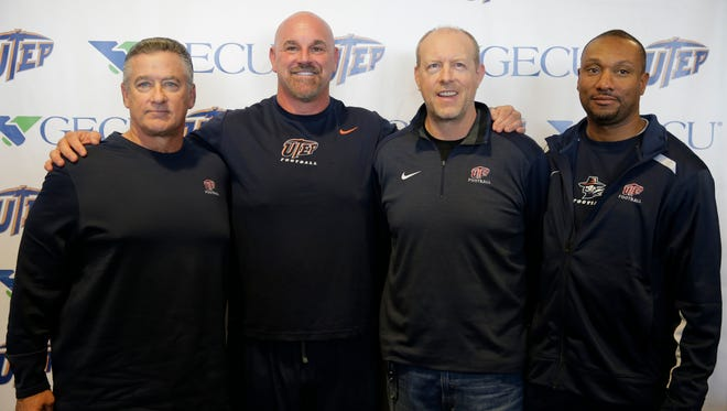 UTEP head coach Sean Kugler (second from left) is all smiles as he stands with newly added Assistant Special Teams Coordinator Don Yanowsky (l), Offensive Coordinator Brent Pease (3rd from right) and Offensive Coordinator and Assistant coach Theron Aych (far right) were introduced at a press conference Thursday afernoon.