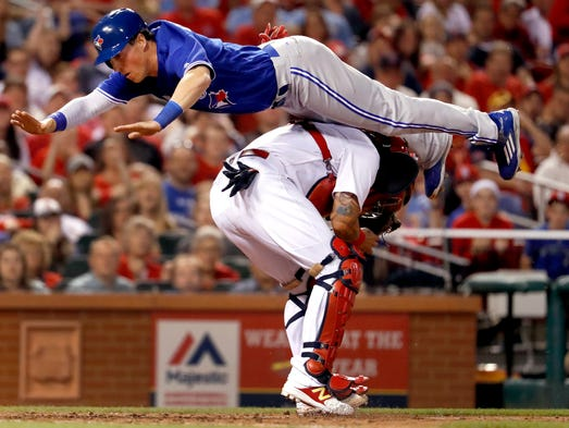 April 25: Blue Jays' Chris Coghlan leaps over Cardinals