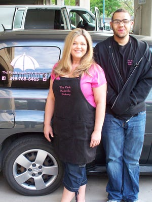 Heather and Christian Sitzmore of Pink Umbrella Bakery are seen Saturday at the Iowa City Farmers Market.