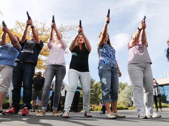 """Teachers practice during a concealed firearm permit class named """"Safe to Learn, Safe to Teach"""" in South Jordan, Utah, Friday, Oct. 16, 2015. The training was reserved for educators free of charge. Utah allows permitted concealed weapons in public schools."""