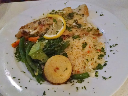 The Oregon sand dabs with vegetables and rice at Si Bon.