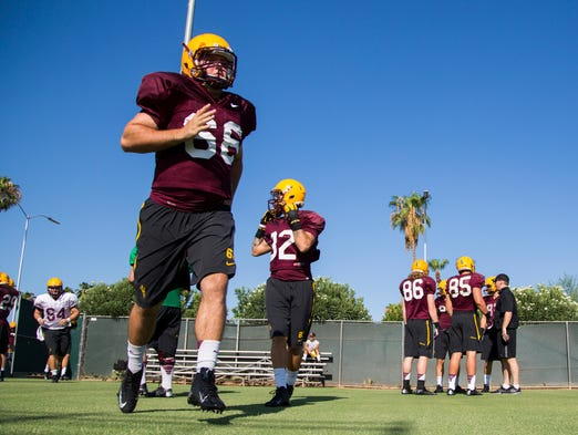 ASU's Donnie Shields runs out to the field during practice at Kajikawa Practice Fields in Tempe on Sunday, August 3, 2014.