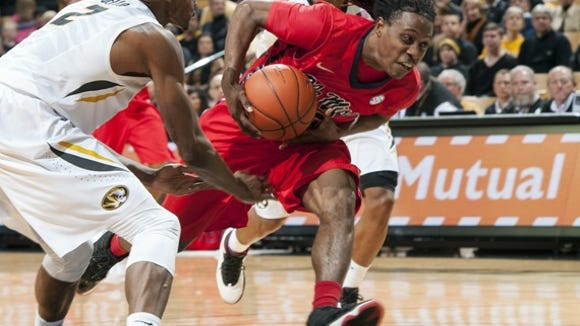 Mississippi's Stefan Moody, right, drives past Missouri's Deuce Bello, left, and Wes Clark during the second half of an NCAA college basketball game Saturday, Jan. 31, 2015, in Columbia, Mo. Mississippi won 67-47. (AP Photo/L.G. Patterson)