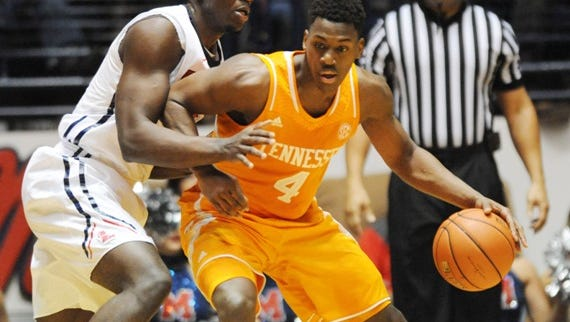 Tennessee forward Armani Moore (4) works against Mississippi center Dwight Coleby during an NCAA college basketball game in Oxford, Miss., Saturday, Feb. 21, 2015. (AP Photo/The Oxford Eagle, Bruce Newman) NO SALES