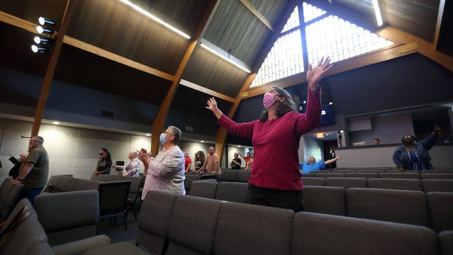 Cheryl Jude, right, of Orient and Patricia Bowers of West Jefferson worship during the 9 a.m. service at Victorious Living Church in Grove City on Sunday. It was the first in-person service for the church since the Covid 19 closures.