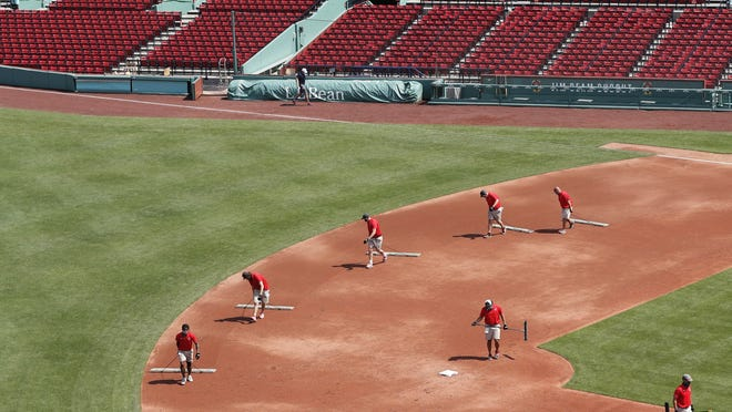 The Red Sox grounds crew drags the infield between the innings of an intrasquad game on Thursday.