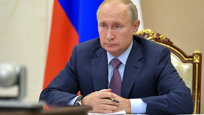 Russian President Vladimir Putin chairs a Security Council meeting via video conference Oct. 14  in Moscow.