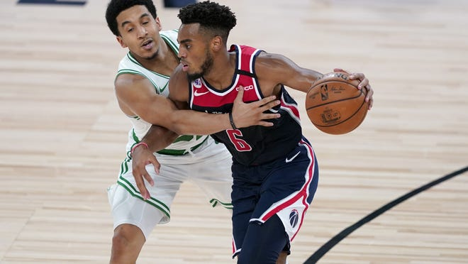 Troy Brown Jr. (6) brings the ball down the court as Boston Celtics guard Tremont Waters defends during the second half Thursday in Lake Buena Vista, Fla.