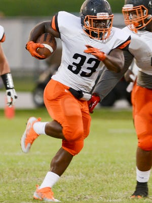 Lasedrick King runs the ball for Cocoa during Friday's game against Viera.