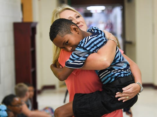 Brenda Terry, a third grade teacher hugs former kindergarten student of her class David Arismendez during the first day of school in Anderson School District 1 at Cedar Grove Elementary in Williamston on Tuesday.
