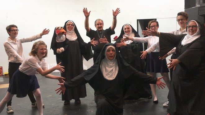 "Father Virgil (Jon Krueger, center) and the Little Sisters of Hoboken put on their first public access channel show in ""Nuncrackers,"" playing at Backdoor Theatre."