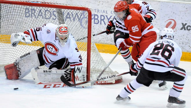 The puck skips St. Cloud State goaltender Charlie Lindgren during the first period of Friday's game at the Herb Brooks National Hockey Center in St. Cloud.