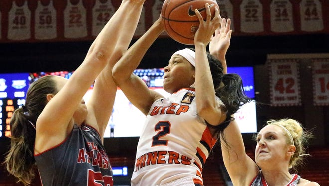 UTEP's Cameasha Turner, center, drives to the basket as Melinda Myers, left, of Florida Atlantic tries blocking her way Saturday in the Don Haskins Center. At right is Florida Atlantic's Alison Gorrell.