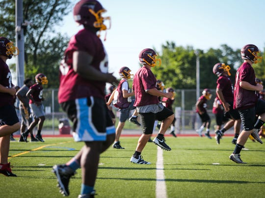 The Milford High School football team warms up as News Journal high school sports reporter Brad Myers tours the state on the first day of football practice.