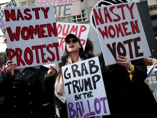 Protesters rally against Donald Trump outside of Trump